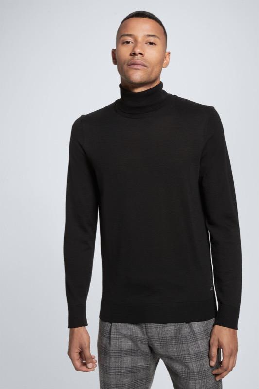 Artikel klicken und genauer betrachten! - Der Merino-Rollkragen-Pullover Martin überzeugt in klassischer Passform aus reiner Schurwolle mit feinen Rippstrick-Abschlüssen – ein smarter Allrounder zu jedem Look.   im Online Shop kaufen